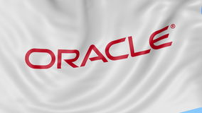Close up of waving flag with Oracle Corporation logo, seamless loop, blue background. Editorial animation. 4K ProRes stock footage