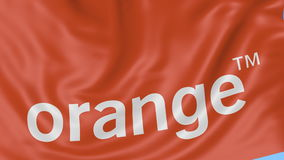 Close up of waving flag with Orange S.A. logo, seamless loop, blue background. Editorial animation. 4K ProRes, alpha. Close up of waving flag with Orange S.A stock video