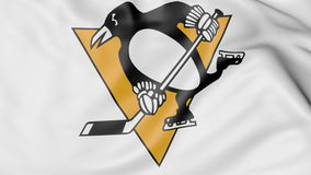 Close-up of waving flag with Pittsburgh Penguins NHL hockey team logo, 3D rendering Royalty Free Stock Photo
