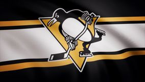 Close-up of waving flag with Pittsburgh Penguins NHL hockey team logo, seamless loop. Editorial animation.  stock images