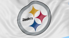 Close-up of waving flag with Pittsburgh Steelers NFL American football team logo, seamless loop, blue background royalty free illustration
