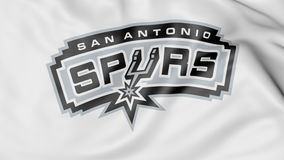 Close-up of waving flag with San Antonio Spurs NBA basketball team logo, 3D rendering Royalty Free Stock Image