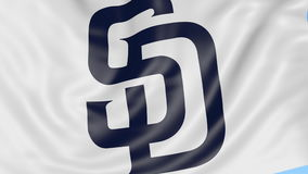 Close-up of waving flag with San Diego Padres MLB baseball team logo, seamless loop, blue background. Editorial stock video footage