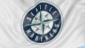 Close-up of waving flag with Seattle Mariners MLB baseball team logo, seamless loop, blue background. Editorial stock video footage