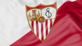 Close-up of waving flag with Sevilla FC football club logo Royalty Free Stock Photography