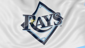 Close-up of waving flag with Tampa Bay Rays MLB baseball team logo, seamless loop, blue background. Editorial animation stock video