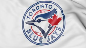 Close-up of waving flag with Toronto Blue Jays MLB baseball team logo, 3D rendering. Close-up of waving flag with Toronto Blue Jays MLB baseball team logo, 3D Stock Images