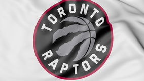 Close-up of waving flag with Toronto Raptors NBA basketball team logo, 3D rendering Stock Images
