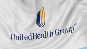 Close up of waving flag with UnitedHealth Group logo, seamless loop, blue background. Editorial animation. 4K ProRes.  stock video