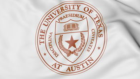 Close-up of waving flag with University of Texas Austin emblem 3D rendering Royalty Free Stock Photo