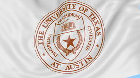 Close-up of waving flag with University of Texas Austin emblem, seamless loop, blue background. Editorial animation. 4K stock video footage