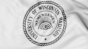 Close-up of waving flag with University of Wisconsin Madison emblem 3D rendering Stock Photos