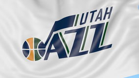 Close-up of waving flag with Utah Jazz NBA basketball team logo, seamless loop, blue background. Editorial animation. 4K. Clip stock video