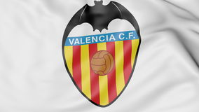 Close-up of waving flag with Valencia CF football club logo, 3D rendering Royalty Free Stock Image
