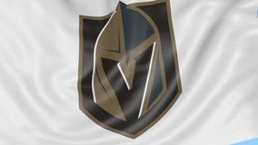 Close-up of waving flag with Vegas Golden Knights NHL hockey team logo, seamless loop, blue background. Editorial. Animation. 4K clip stock video