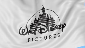 Close up of waving flag with Walt Disney Pictures logo, seamless loop, blue background. Editorial animation. 4K ProRes.  stock footage