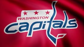 Close-up of waving flag with Washington Capitals NHL hockey team logo, seamless loop. Editorial animation stock video