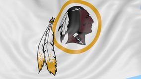Close-up of waving flag with Washington Redskins NFL American football team logo, seamless loop, blue background. Editorial animation. 4K clip stock video