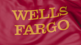 Close up of waving flag with Wells Fargo logo, 3D rendering. Close up of waving flag with Wells Fargo logo, United States Royalty Free Stock Images