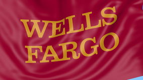 Close up of waving flag with Wells Fargo logo, seamless loop, blue background. Editorial animation. 4K ProRes, alpha stock video footage