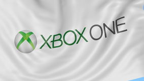 Close up of waving flag with Xbox One logo, seamless loop, blue background. Editorial animation. 4K ProRes, alpha. Close up of waving flag with Xbox One logo stock footage