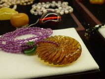 Beeswax craft jewelry. A close-up of the wax crafts, sold at the mall counter Royalty Free Stock Photos