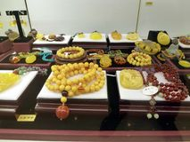 Beeswax craft jewelry. A close-up of the wax crafts, sold at the mall counter Stock Photo