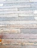 Deck Floor as a textured background. Close up of a weathered and grungy wooden deck floor royalty free stock images