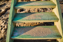 Close up of Weathered and Sandy Beach Stairs. A close up shot of some old weathered beach stairs covered in sand on a sunny day in Cape Cod Stock Photos