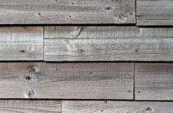 Wood cladding. Close up of weathered wooden cladding on a barn Stock Photography
