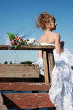 Close-up of wedding bouquet with bride Royalty Free Stock Image