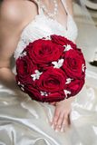 Close up of a wedding bouquet. Close up of a bride holding a wedding bouquet with red roses Stock Photo