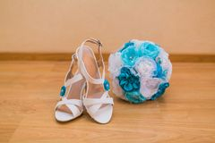 Close up of wedding bouquet and bride shoes Stock Photography