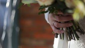 Close up of wedding bouquet. Close-up of vivid wedding bouquet at bride hands. Wedding flowers, bridal bouquet closeup stock photo