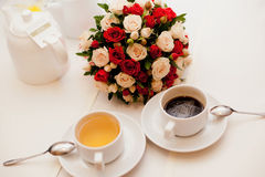 Close up of wedding bouquet. With a cup of tea and coffee Royalty Free Stock Photos