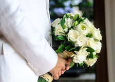 Close up of wedding bouquet in groom hands Stock Photography