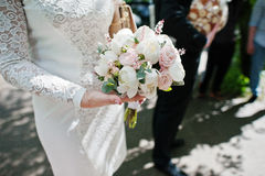 Close up wedding bouquet at hand of bridesmaid. Royalty Free Stock Photos