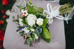 Close up of wedding bridal bouquet with roses on the chair Stock Photo