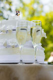Close-up of wedding cake and champagne flutes Stock Photo