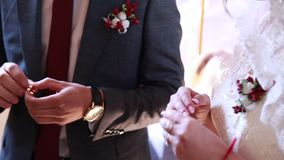 Close-up, wedding ceremony in the church, the groom with the usual exchange of wedding rings. Ukraine stock video