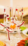 Close-up of wedding decorated champagne glasses on the table Stock Images