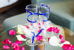 Close-up of wedding decorated champagne glasses on the table Stock Photo
