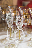 Close-up of wedding decorated champagne glasses on the table Royalty Free Stock Image