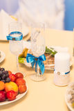 Close-up of wedding decorated champagne glasses on the table Royalty Free Stock Images
