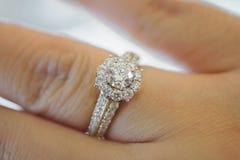 Wedding diamond ring on woman finger Stock Image