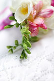 Close up of the wedding dress detail. With freesia Royalty Free Stock Image