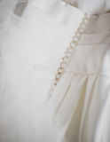 Close-up of wedding dress details. Buttons on a wedding dress Royalty Free Stock Photography