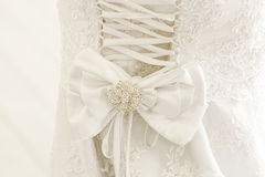 A close up of a wedding dress with a large silk bow Royalty Free Stock Photo
