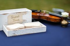 Close up of wedding guest book and violin on the table Stock Photo