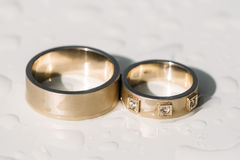 Close up of wedding ring on wooden table Royalty Free Stock Image